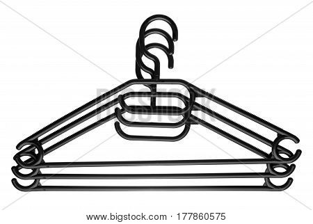 Three black plastic clothes hangers superimposed on top of each other isolated on white background