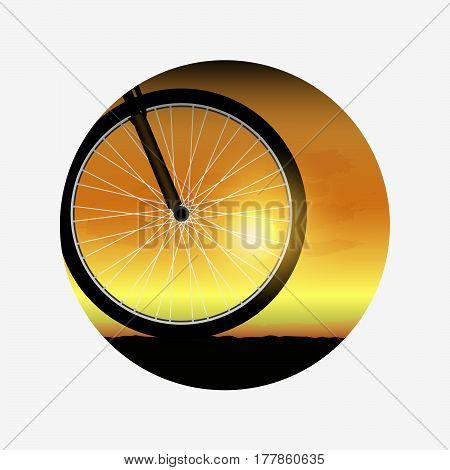 Bicycle wheel at sunset, silhouette of bike forward to sunset. Outdoor leisure.