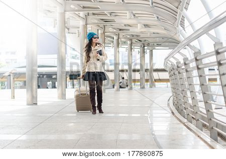 Young Woman Tourist Walking With Suitcase At Transport Hubs.