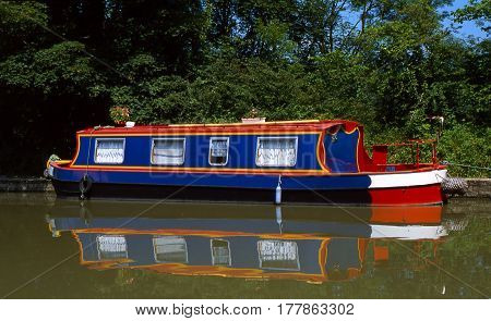 Houseboat moored beside towpath of a canal