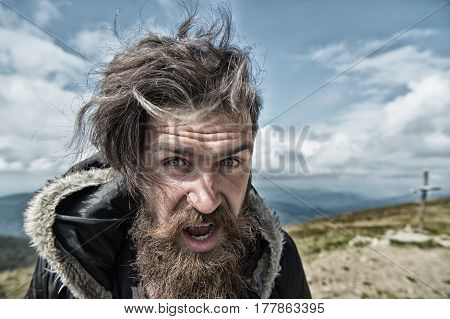 Bearded Man, Brutal Caucasian Hipster With Moustache On Windy Mountain