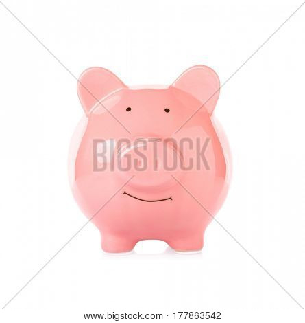 Pink ceramic piggy bank on white background