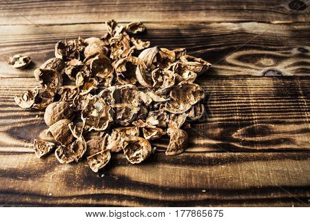 a shell of walnuts on wooden background