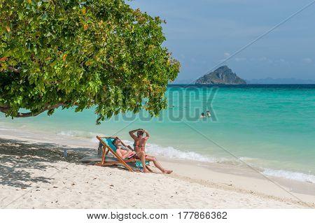 PHI PHI ISLANDS, THAILAND - FEBRUARY 22: Tourists enjoy Laem Tong Beach at Phi Phi Islands. Phi Phi Islands are a popular tour destination from Phuket and Krabi.
