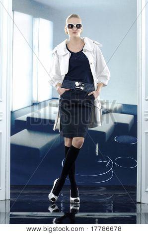 Beautiful fashion model posing posing in the studio