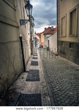 Lovely narrow cobble street with beautiful townhouses in Lesser Town district, Prague, Czech republic