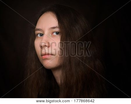 Portrait of a young girl with long hair. Unusual beauty