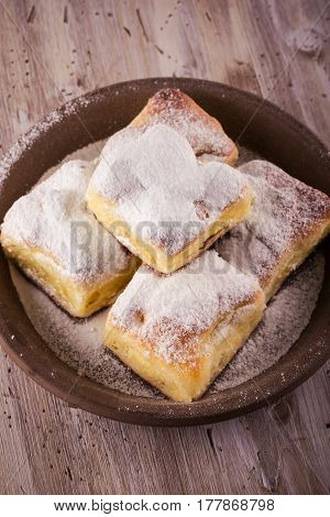 Top View On Homemade Traditional Cakes Filled By Curd On Wooden Board