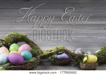 Colorful easter eggs in nest with moss brunch