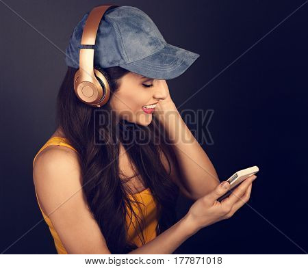 Beautiful Calm Young Woman In Blue Cap Listening The Music In Wireless Headphone And Looking Happy O
