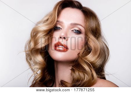 Beautiful young girl with orange lips and curly hair
