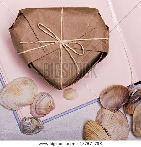 Sea souvenir heart box on travel sketchbook memories diary