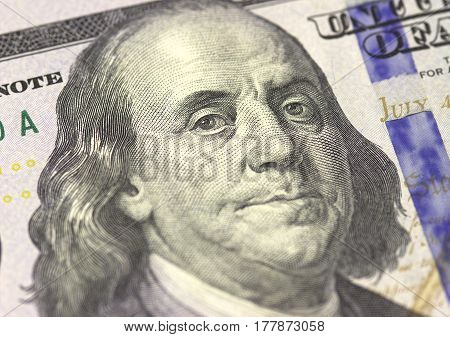 Benjamin Franklin face on US hundred or 100 dollars bill macro, united states money closeup