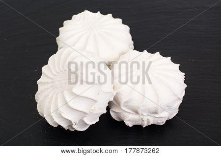 Sweet delicacy of marshmallows on black. Studio Photo