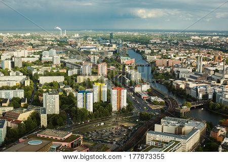 Travel to Germany. View of the houses and streets of Berlin with a bird's-eye view. Overcast sky in Berlin. Light from the sun on the houses. Residential houses. Megapolis in Berlin. European city