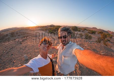 Smiling Adult Couple Taking Selfie In The Namib Desert, Namib Naukluft National Park, Main Travel De