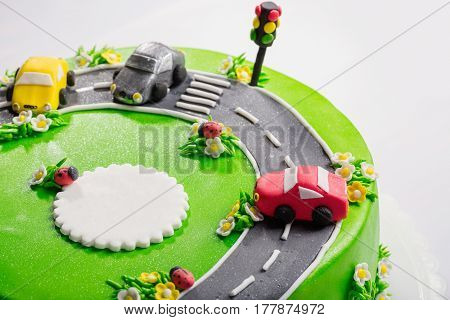 Delicious cake with ladybugs cars and traffic light with free place for text close up.