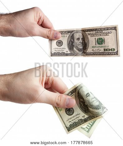 A man's hand holds an American one hundred dollar bill. on a white background