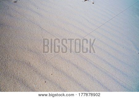 Beautiful and natural waves of sand on the beach. New Providence, Nassau, Bahamas.