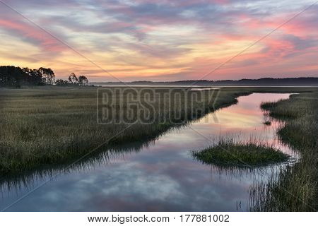 Clouds Refecting in Water of Salt Marsh at Sunrise