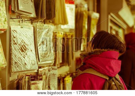 Eskisehir, Turkey - March 13, 2017: Woman Examining Goods In Mall