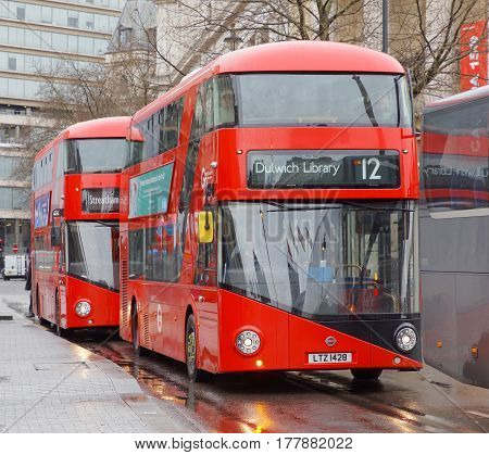 LONDON GREAT BRITAIN - FEB 27 2017: Red double decker buses on the rainy street. February 27 2017 in London Great Britain