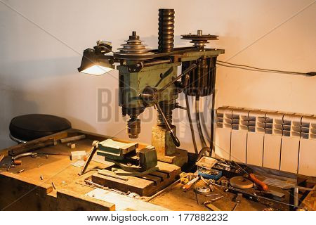 Workplace with a drill and vice. Work at a factory. Drilling Machine. Workplace concept