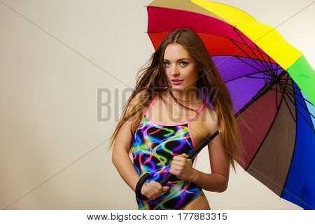 Happy Woman Posing In Swimsuit And Colorful Umbrella
