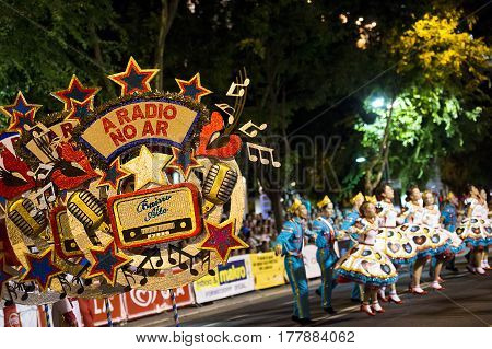 Lisbon Portugal - June 12 2014: People wearing costumes at the parade of popular marches (Marchas Populares) during the Saint Anthony Feast at the Liberdade Avenue (Avenida da Liberdade) in Lisbon Portugal