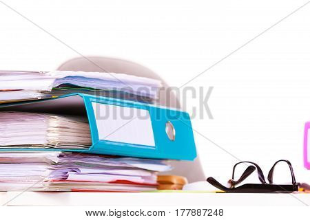 Paperwork. Stack of file folders ring binders on office table dask.