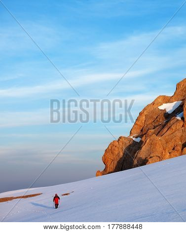 Hiker at sunrise snow mountains. Turkey Central Taurus Mountains Aladaglar (Anti-Taurus).