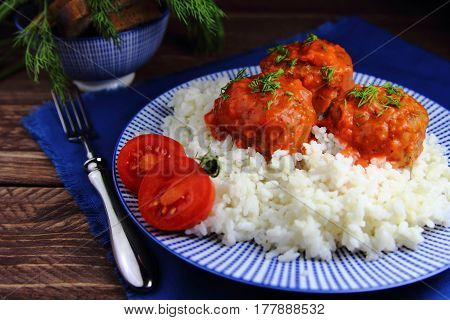 meatballs in tomato sauce with rice and tomatoes
