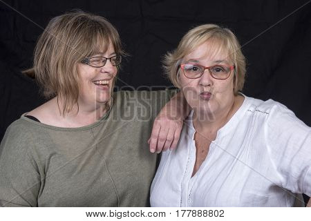 Portrait of two mature women laughing and having fun