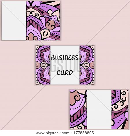 purple template business cards with oriental pattern and geometric circle element. Vintage decorative mandala pattern. Decorative floral business cards, vector template.