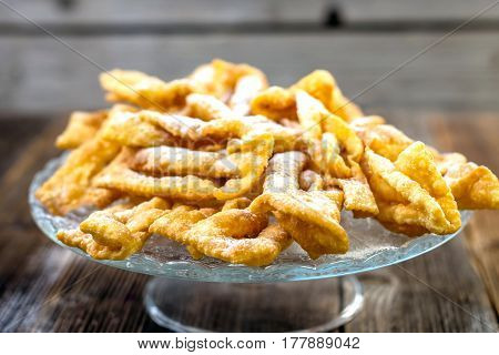 Flancat- crisp deep fried pastry dusted with powdered sugar