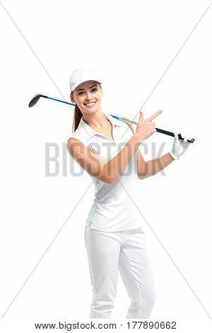 Pretty woman golfer posing with golf club on white background in studio