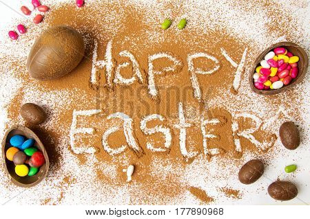 Happy Easter Note In Cacao Powder With Chocolate Eggs
