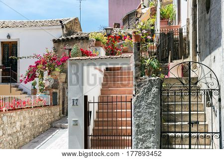 TAORMINA ITALY - MAY 17 2016: Courtyard with stairs and plants in Taormina at Sicilian Island Italy