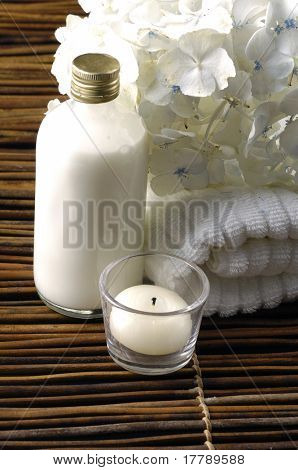 spa concept with orchid and candles , massage oil