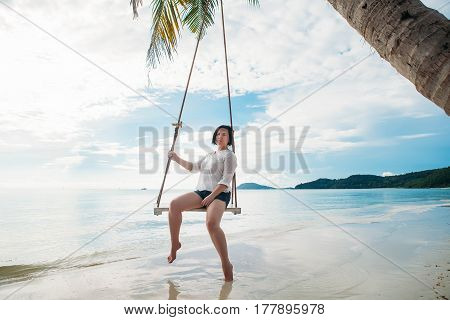 Happy woman on a swing tropical island phu quoc