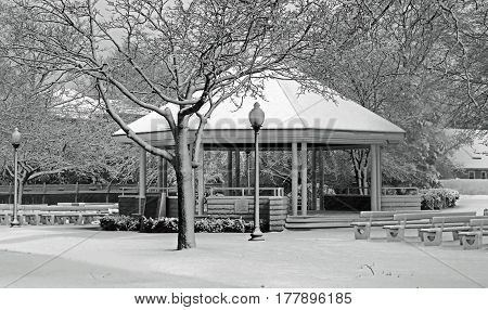 The Babylon Village Gazebo blanketed after a snow shower in black and white