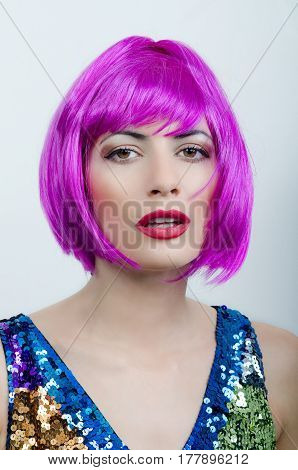 a girl is in a pink wig
