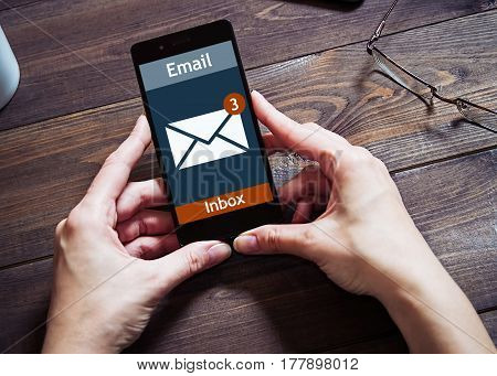 The woman received an e-mail online on a mobile phone. Message online icon.