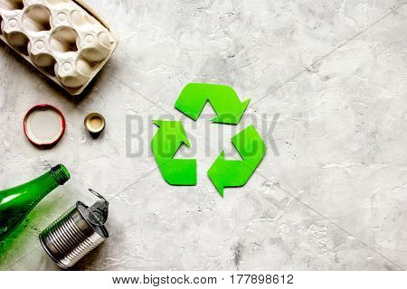 waste recycling eco symbol with garbage disposal on stone table background top view mockup