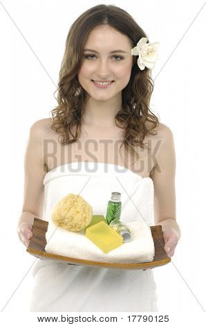 portrait of Young beautiful woman holding a tray with lotion and washtub, white towels
