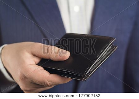 Business man hold in his hand leather wallet