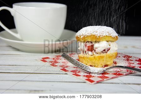 strawberries and whipped cream cake dessert with powdered sprinkling