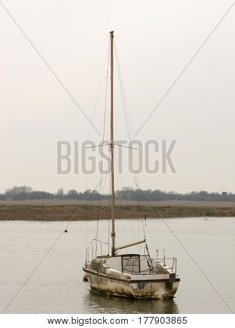 A solitary boat stationed off of Wivenhoe.