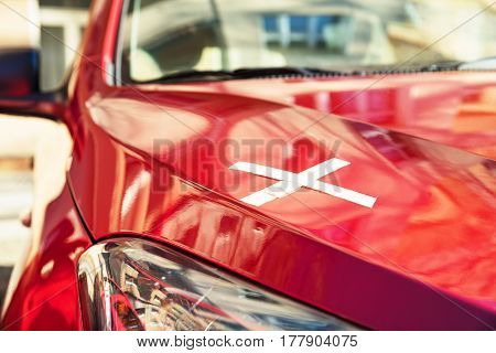 Close-up Of A Bandage On New Red Car