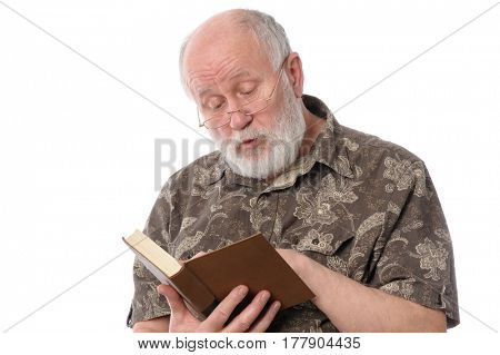 Handsome bald and bearded senior man in eyeglasses reading a book, isolated on white background